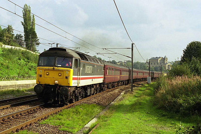 47826 'Springburn' accelerates through Crossflatts with 5Zxx 1240 empty stock from Ferme Park to Carnforth off a steam-hauled Kings Cross to Darlington charter the previous day (24/09/2006)