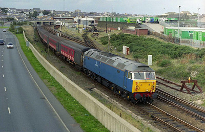 Flanked bu the new 'A5' dual carriageway, and the site of the old Holyhead MPD, 47709 shunts the stock into the station yard (07/10/2006)
