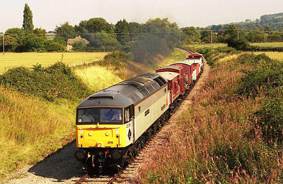 Although there was only a short turnaround time between the two trains at Toddington, it was still possible to dive into the car and drive to the overbridge at Hailes to phot 47376 working the 1202 Toddington to Winchcombe freight... (10/09/2006)
