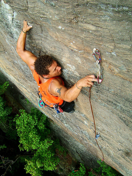 Kelsey fights back the pump to make the clip on <i>Oz 5.11c</i> at the Emerald City Wall.