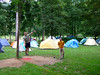 Voytek works the slackline permanently rigged in camp at Miguel's Pizza, the world famous climber's campground at the Red River Gorge.