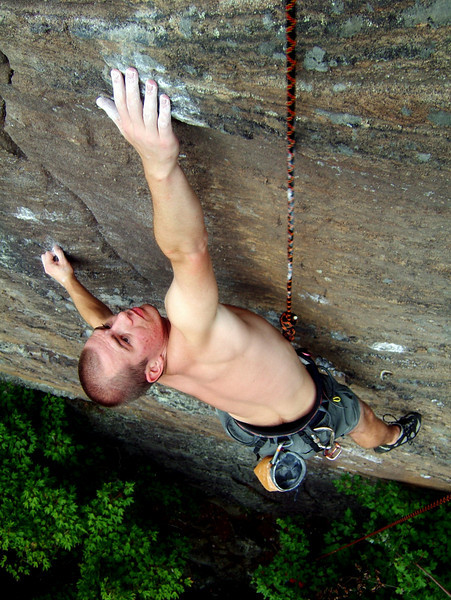 Voytek wishes he was three inches longer, stretching through the crux on <i>Oz 5.11c</i>.