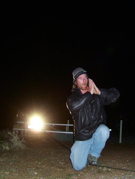 Seth takes a knee by headlight in camp after dinner.