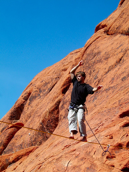 Showing a mighty defiance for gravity, Dylan Buffington walks out on air on the longer of the two highlines we rigged.