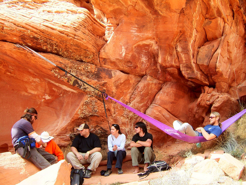 Slackers relax as they watch others make attempts at the highlines.