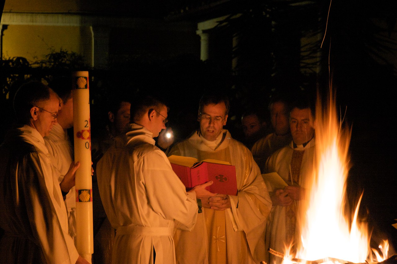 Blessing the fire • The Rector of the English College, who was celebrating the Easter Vigil Mass, blesses the new Easter Fire in the garden of the College before lighting the Paschal Candle and then processing into the church.