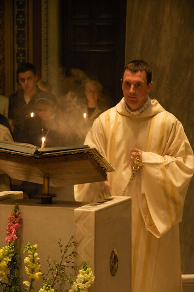 Incensing • John incenses the Book of the Gospels before proclaiming the Gospel at the Easter Vigil.
