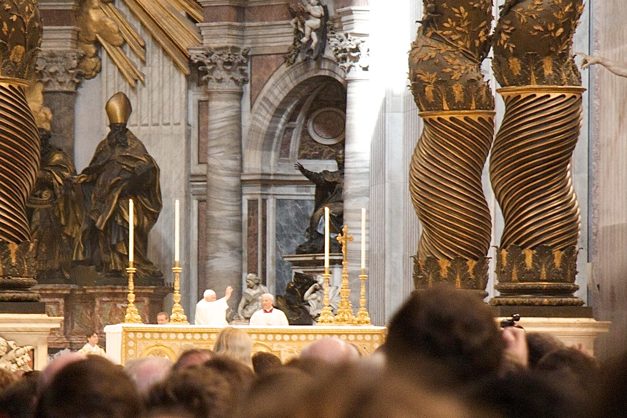 The Pope blesses the congregation after reverencing the altar upon his arrival on the sanctuary for the Chrism Mass.