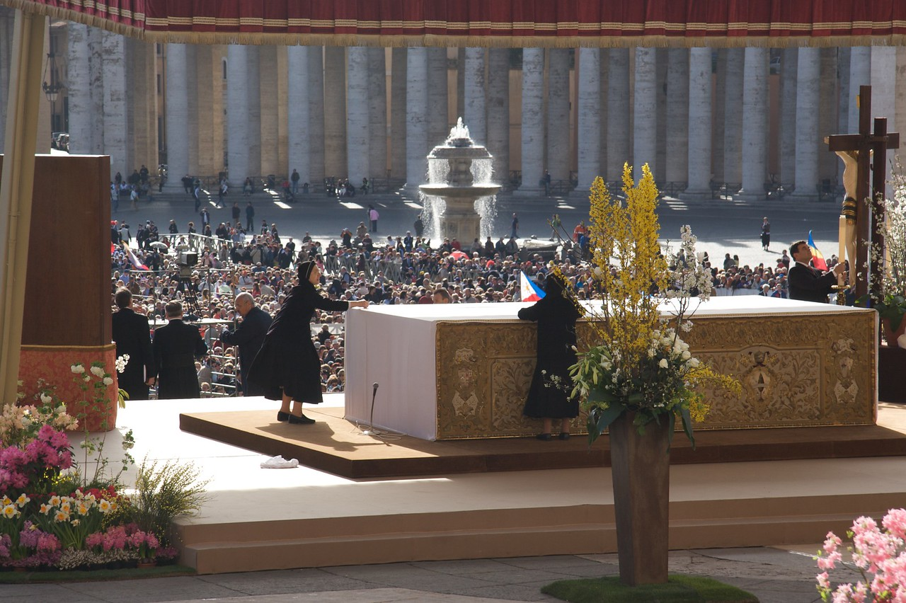 Preparing the Altar • Nuns prepare the altar for the Papal Mass of the Resurrection on Easter Sunday. It's very soon after 9am: the Mass began at 10.30am.