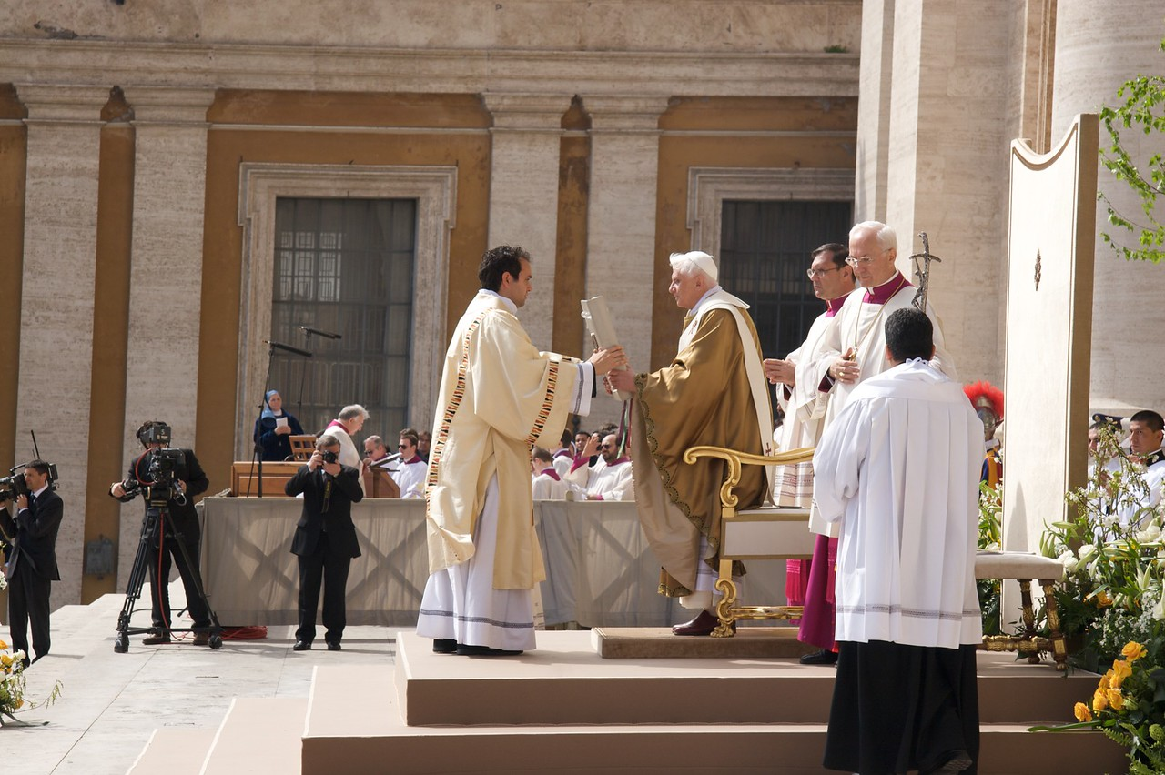 Receiving the Book of the Gospels • The Pope is handed Book of the Gospels by the Deacon after he proclaimed the Gospel.
