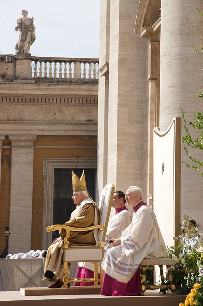 Liturgy of the Word • The Pope, flanked always by two MCs, sits for the Liturgy of the Word at the main Mass in St Peter's Square on Easter Sunday.