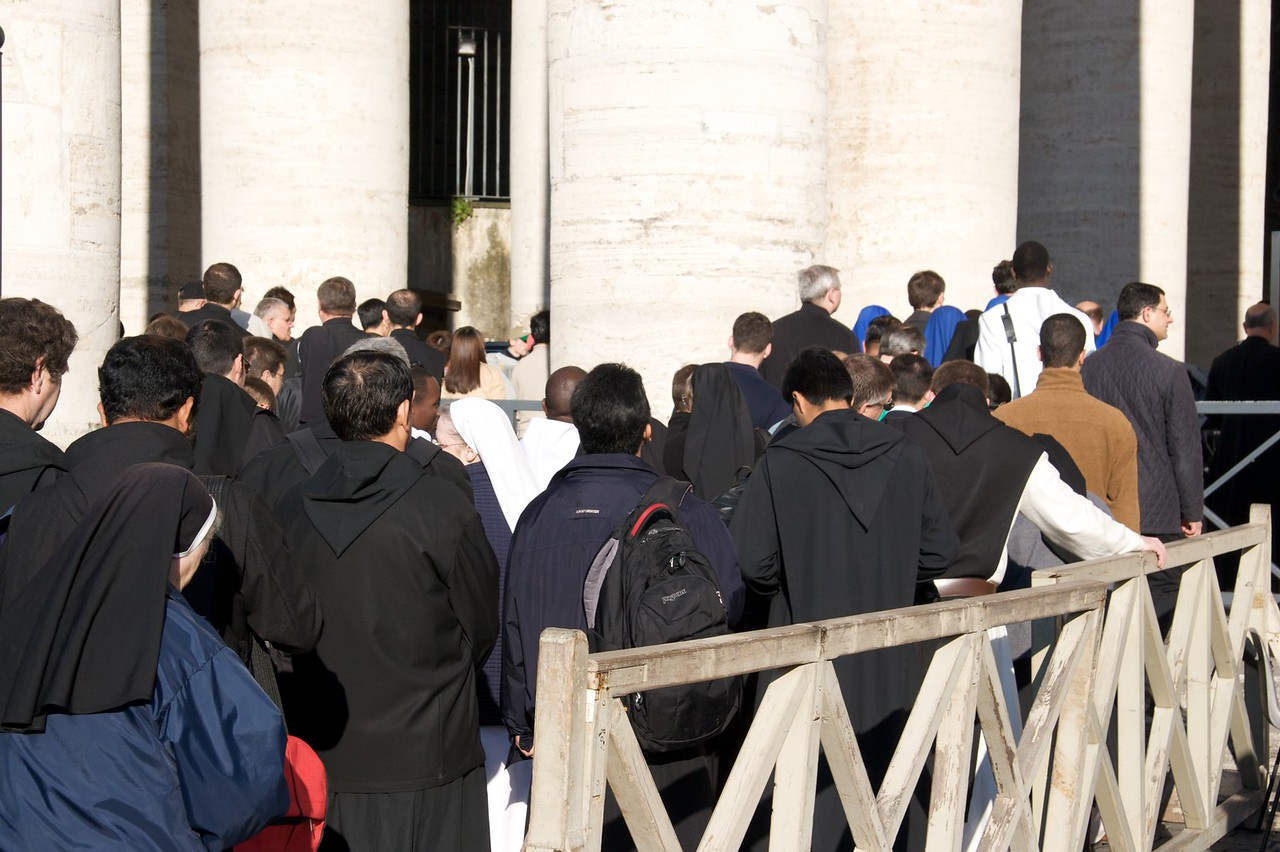 Queue for the Chrism Mass • A queue of people outside St Peter's Basilica, gradually filtering into the church in order to join the congregation for the Diocese of Rome's Chrism Mass on Maundy Thursday. The Mass was celebrated by the Pope; we got seats in the nave of the church, but quite far back from the sanctuary.