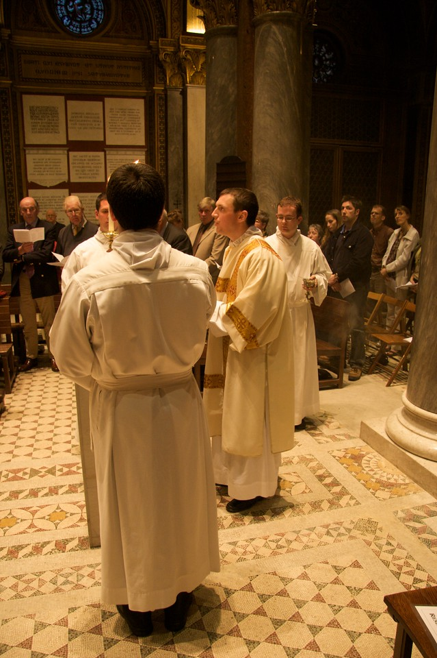 Reading the Gospel • John reads the Gospel in the church of the Venerable English College at the Mass of the Last Supper on the evening of Maundy Thursday.