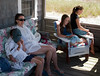 Benjamin, Chantal, Isabel, and Megan on the porch.