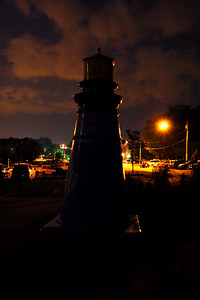 The lighthouse is dark, but the darkness is light