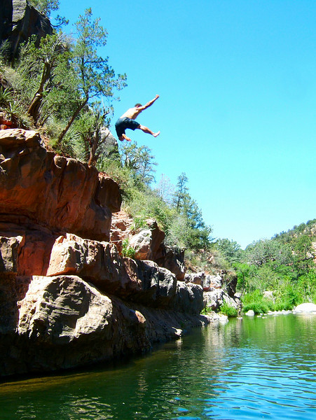 Kelsey takes to the sky at Grasshopper Point, over Oak Creek.