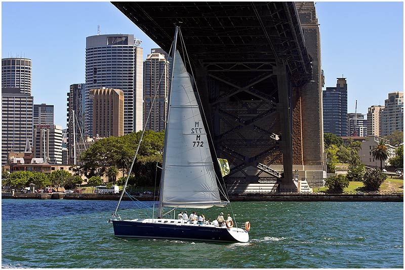 Sydney Harbour, Friday September 22nd 2006. <br /> <br /> Sailing under the harbour bridge. <br /> <br /> <br /> EXIF DATA <br /> Canon 1D Mk II. EF 70-200f/2.8L@90mm 1/100s f/18 ISO 200.