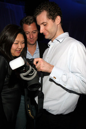PMC Photographer Christiaan Gratan shows Susan Shin and friend his artistry with the camera