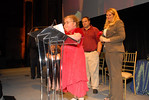 Kristina Schultz gives speech while her family and donor Shannon Behrhof look on
