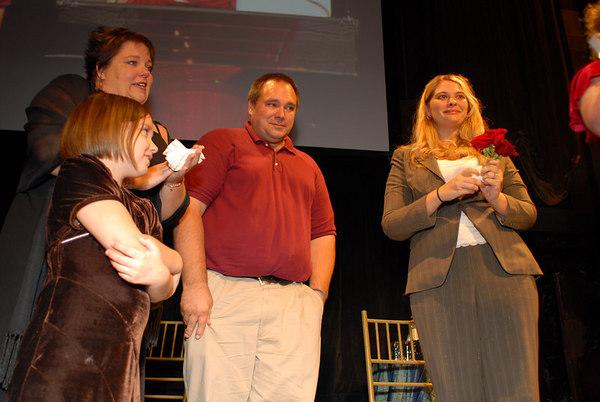 Kristina Schultz Family and Shannon Behrhof listen to Kristina Schultz speech.