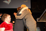 Kristina Schultz looks on as her mother Lori Schultz hugs donor Shannon Behrhof