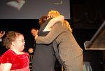 Kristina Schultz looks on as her mother Lori Schultz hugs donor Shannon Behrhof
