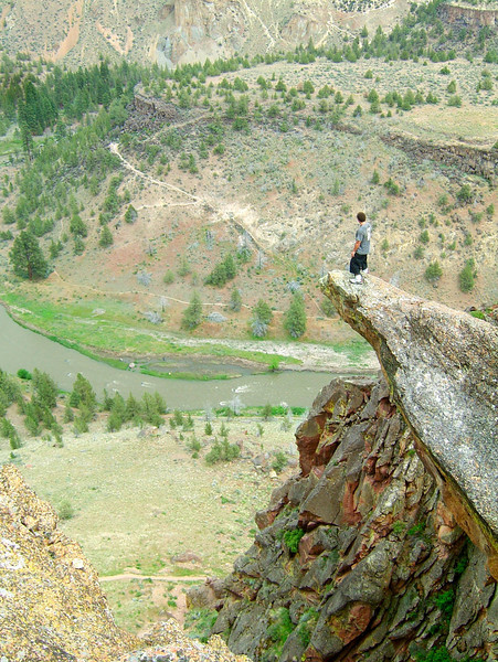 Kelsey steps out on an overhanging point at Smith Rock.