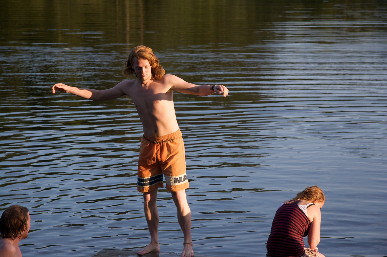 Will he? Won't he? • Ben Dollard balancing precariously on the jetty at lower lake in Gilling.