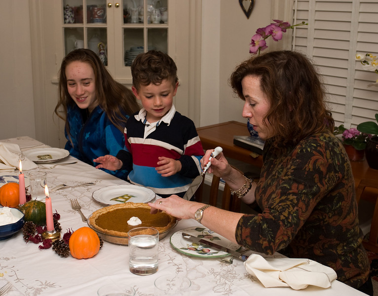 Isabel and Joey watch Caroline cutting the pumpkin pie