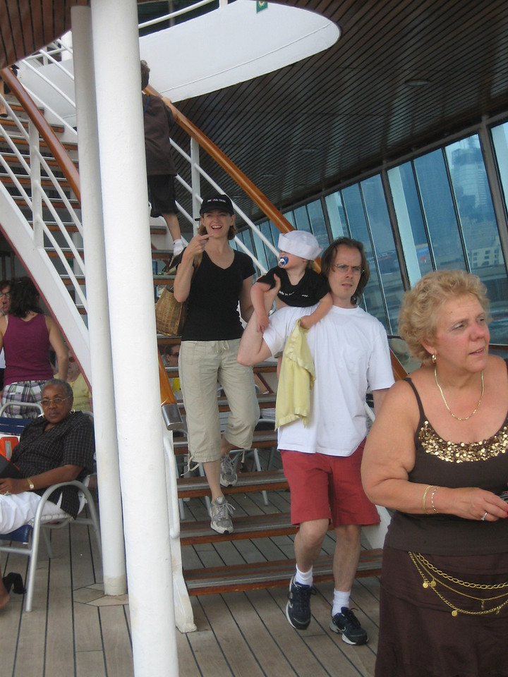 The Torontos arriving on deck. (And some other woman with quite an outfit.)