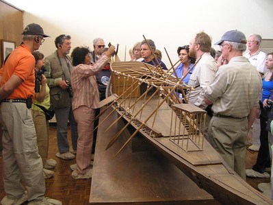 Sonia el Masri points out features on a model of the Solar Barque to the group  -Ed Turner