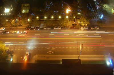 The street below our hotel room. Several cars passed by during the 3 second exposure.