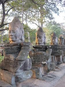 Demons guarding Angkor Thom - Leslie Rowley