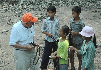 Ray Close negotiating children selling rubber nut necklaces - Val Fitch