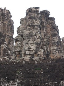Face looming in the Bayon - Leslie Rowley
