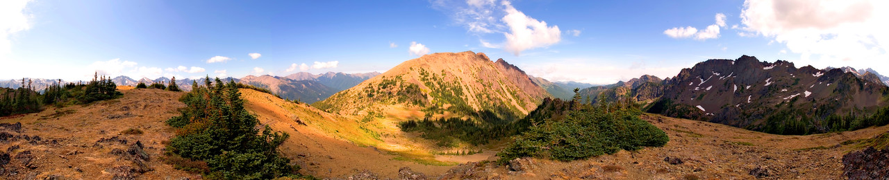 This is a nearly-360 degree panorama from the ridge up above Marmot Pass. In this shot(s) I somehow missed the Olympic Range off to the right. Marmot Pass is in the little saddle just left of center.