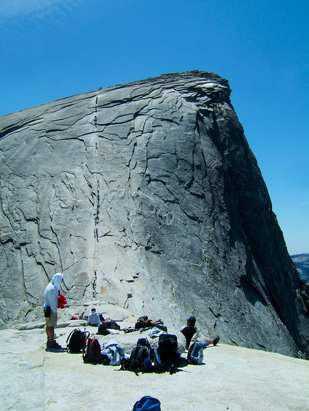 The regular tourist trail up Half Dome is the cable route, a pair of cable railings secured to the rock with large posts.  We hiked back along this route.