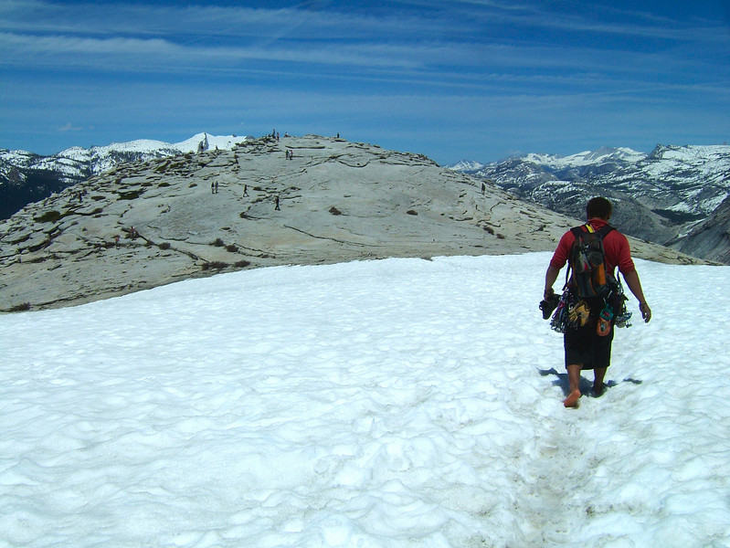 We topped out on Half Dome's summit in midday, with hordes of tourists who took the easy way all around.  After being in climbing shoes for hours on end, Kelsey's feet enjoyed the snow.
