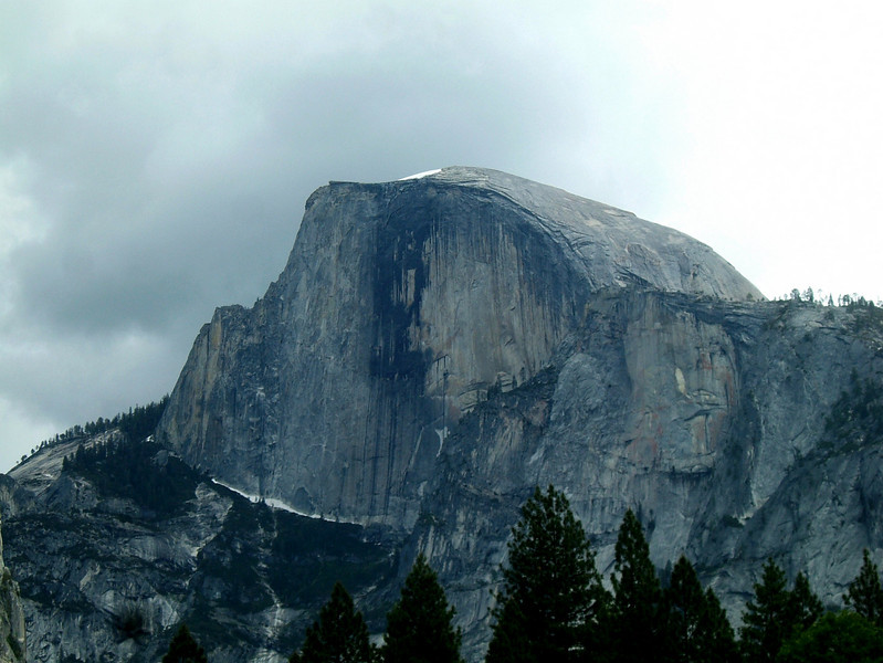Half Dome, seen from the valley floor as a cloud front moves in.  We climbed it a couple days later.