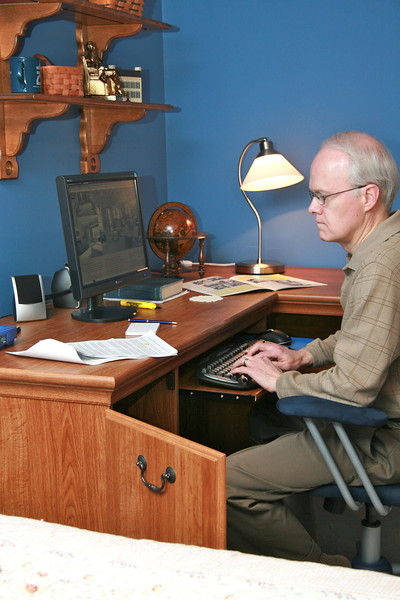 "Larry Stewart working on ""Season of Rochester College"" in his home office"