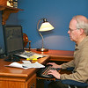 """Larry Stewart working on """"Season of Rochester College"""" in his home office"""