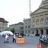 Setting up at Bundesplatz.  That's the Bundeshaus (Federal assembly building) on the right.  Curia Confoederationis Helveticae means Court of the Swiss Confederation.