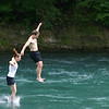 Couple jumping into the Aare River from the Schönausteg foot bridge.