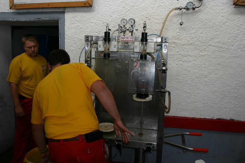 The machine that fills the 2 liter bottles.