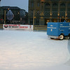 "Resurfacing the ice at Bundesplatz.   Deborah saw the ""WELCOME TO ICE HOCKEY COUNTRY"" sign and thought, ""Canada?""."