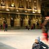 Ice skating at Bundesplatz.  The child falls.