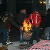 Warming by the fire at the Wintergrillfest at Waisenhausplatz