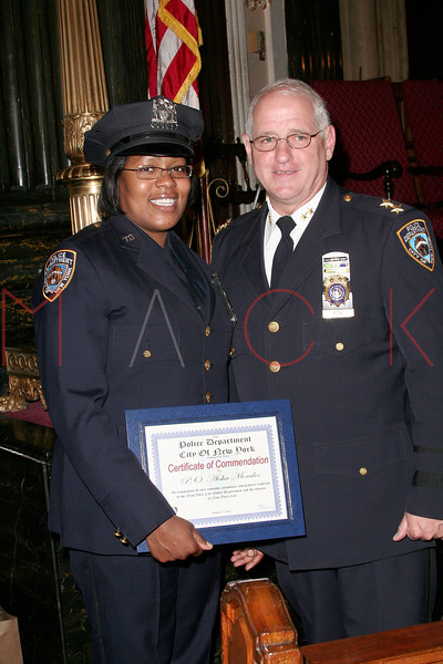 NEW YORK Ð October 7: P.O. Aisha Morales and Inspector Thomas J. Harris (70th Precinct Commanding Officer) at The 70th Precinct Medal Day and Appreciation Day Award Ceremony.  (Photo copyright 2007 by Steve Mack/S.D. Mack Pictures).
