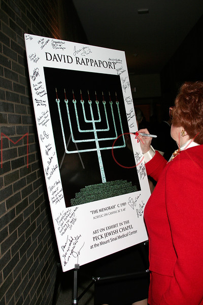 """NEW YORK - October 16: Bernice Arnold signing """"THE MENORAH"""" poster at The installation of """""""