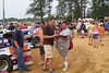 A fan gets an autograph from one of the Super Late Model stars